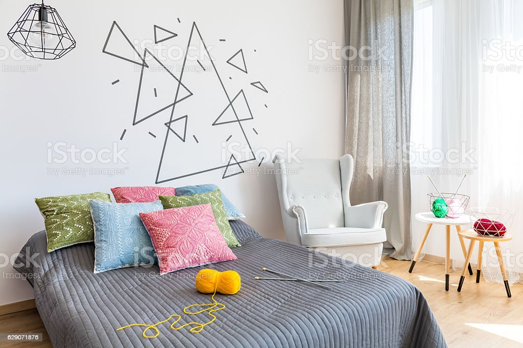 Bedroom with knitting accessories stock photo