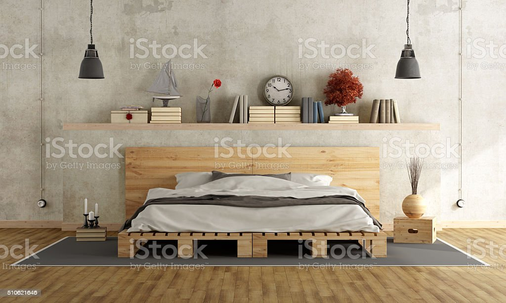 Bedroom with pallet double bed stock photo