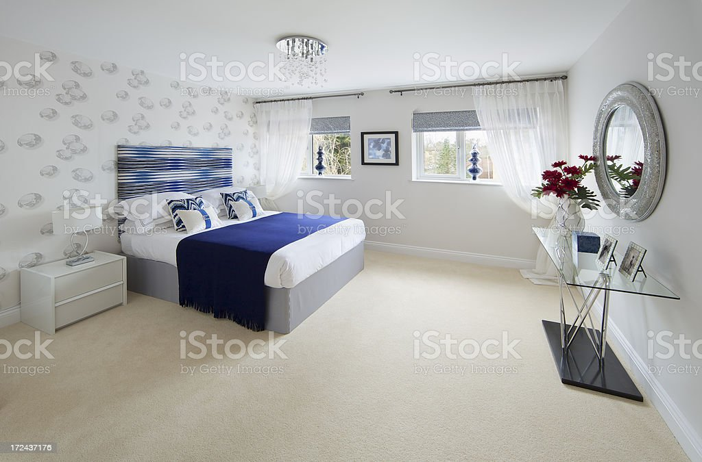 bedroom with red flowers royalty-free stock photo