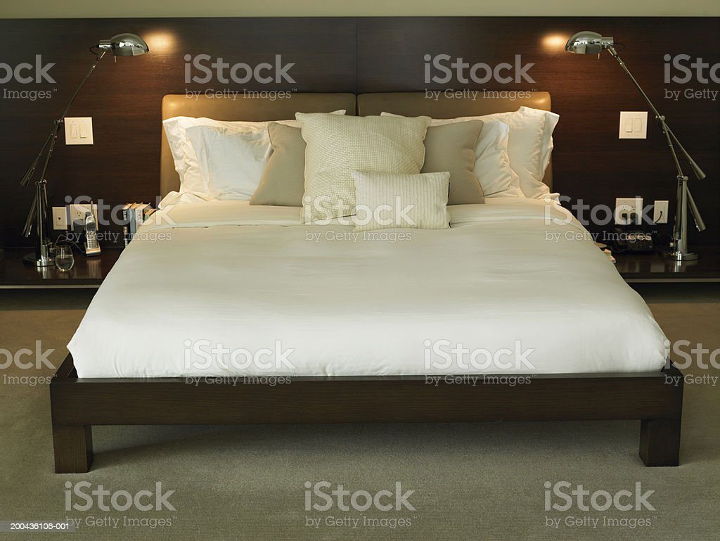 Bedroom with two lit lamps stock photo