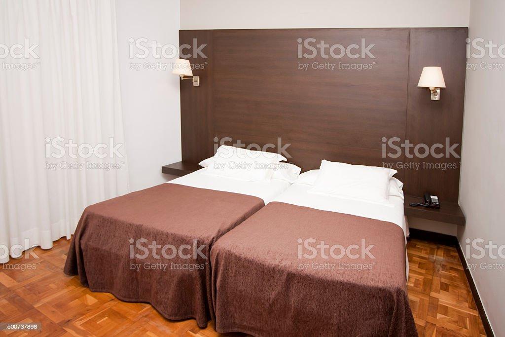 Bedroom, wooden headboard. stock photo