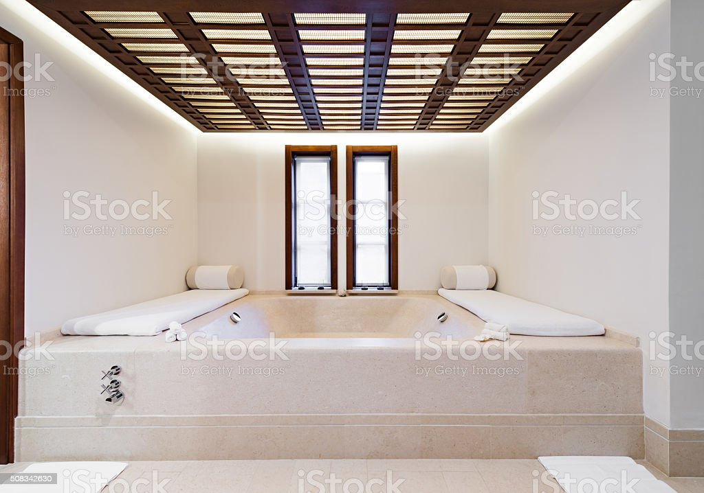 Beds and jacuzzi in a luxury health spa stock photo