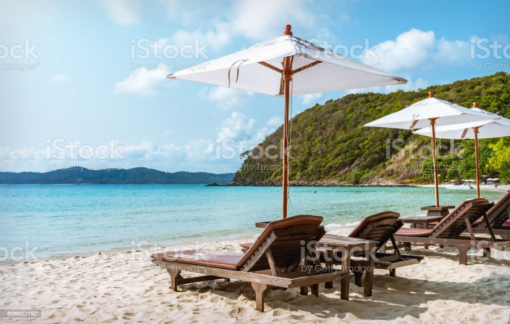 beds and umbrella on a tropical beach stock photo