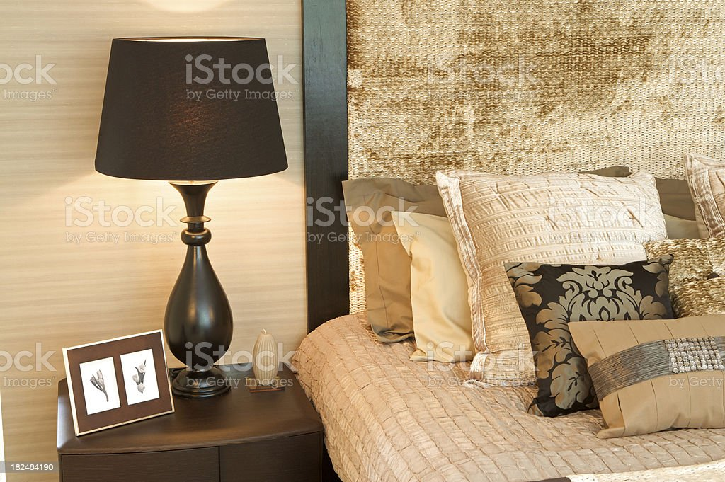 bedside lamp and cushions royalty-free stock photo