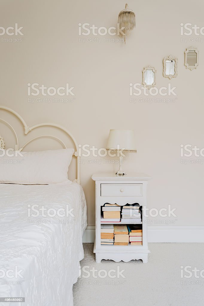 Bedside table with books stock photo