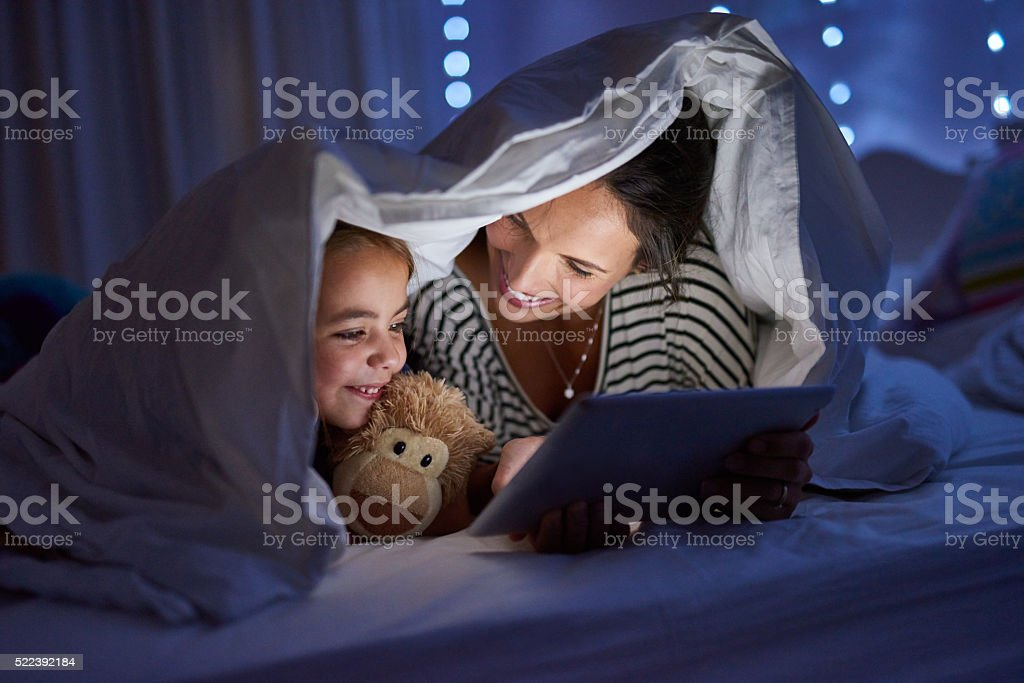 Bedtime meets playtime stock photo