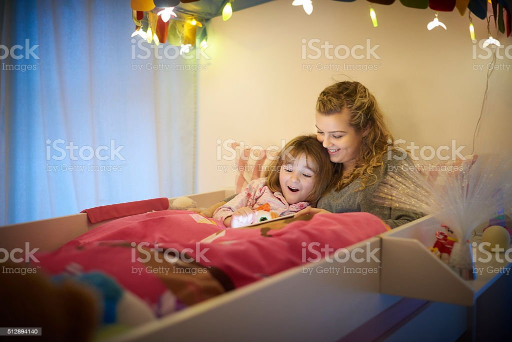 bedtime touchscreen stock photo