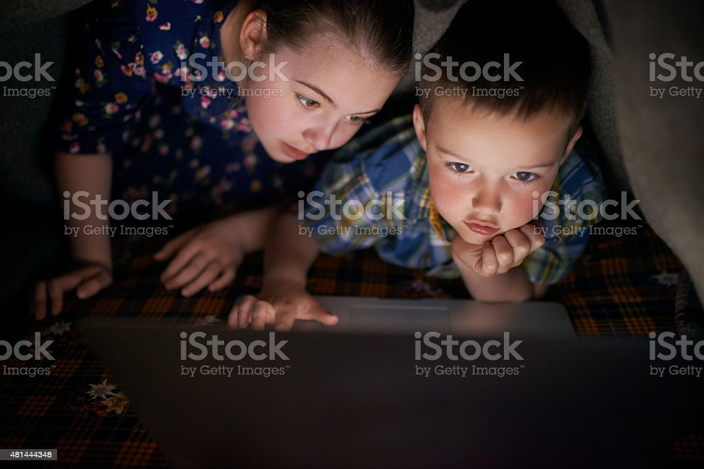 Bedtime turns into movie time stock photo