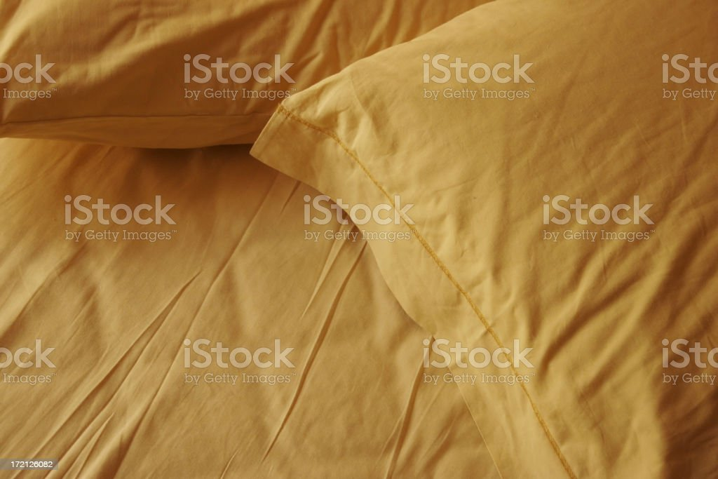 bedtime yellow pillows background royalty-free stock photo