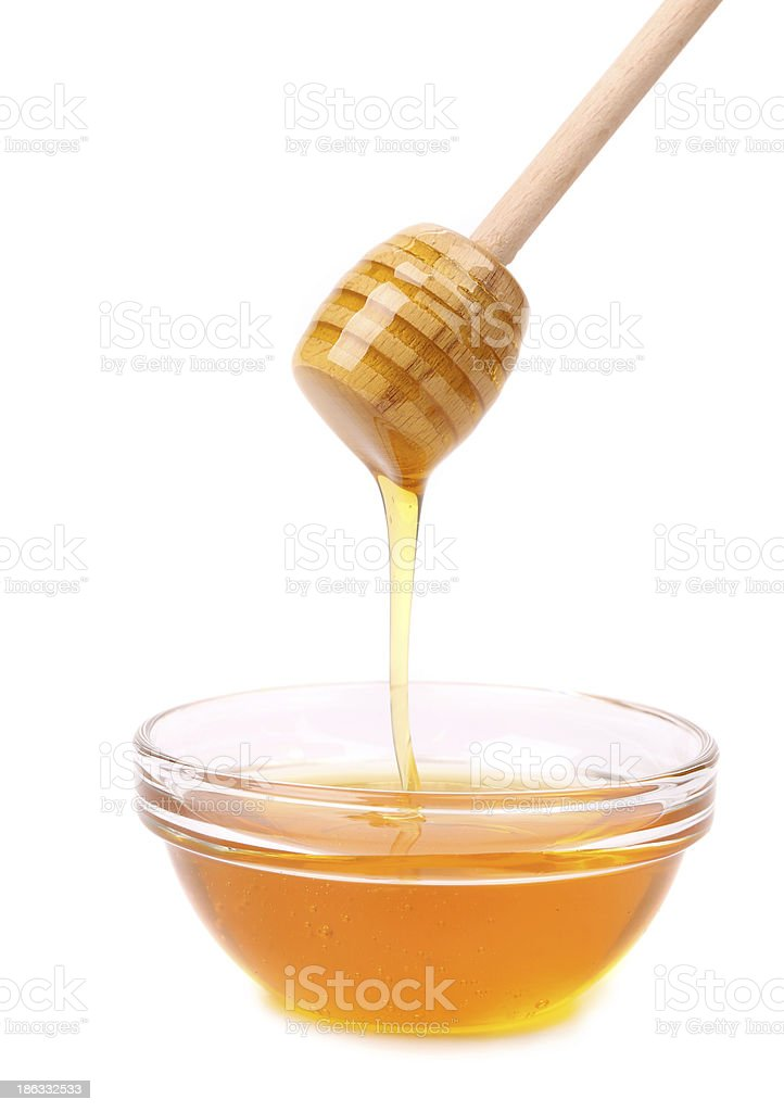 Bee honey with wooden dipper. royalty-free stock photo