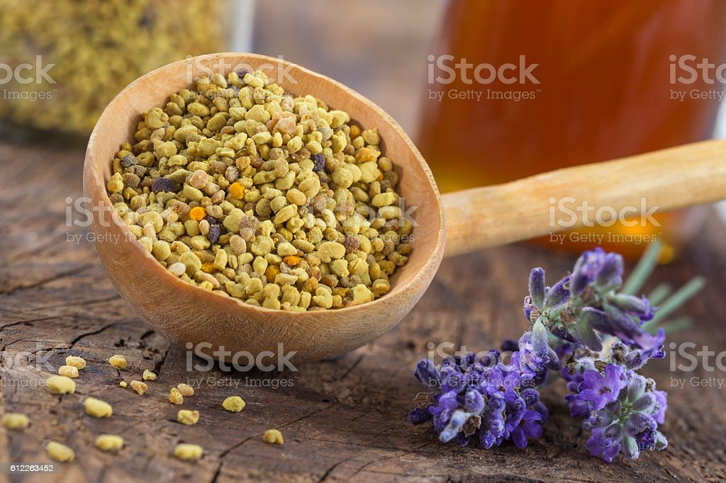bee pollen in the spoon on  wooden background stock photo