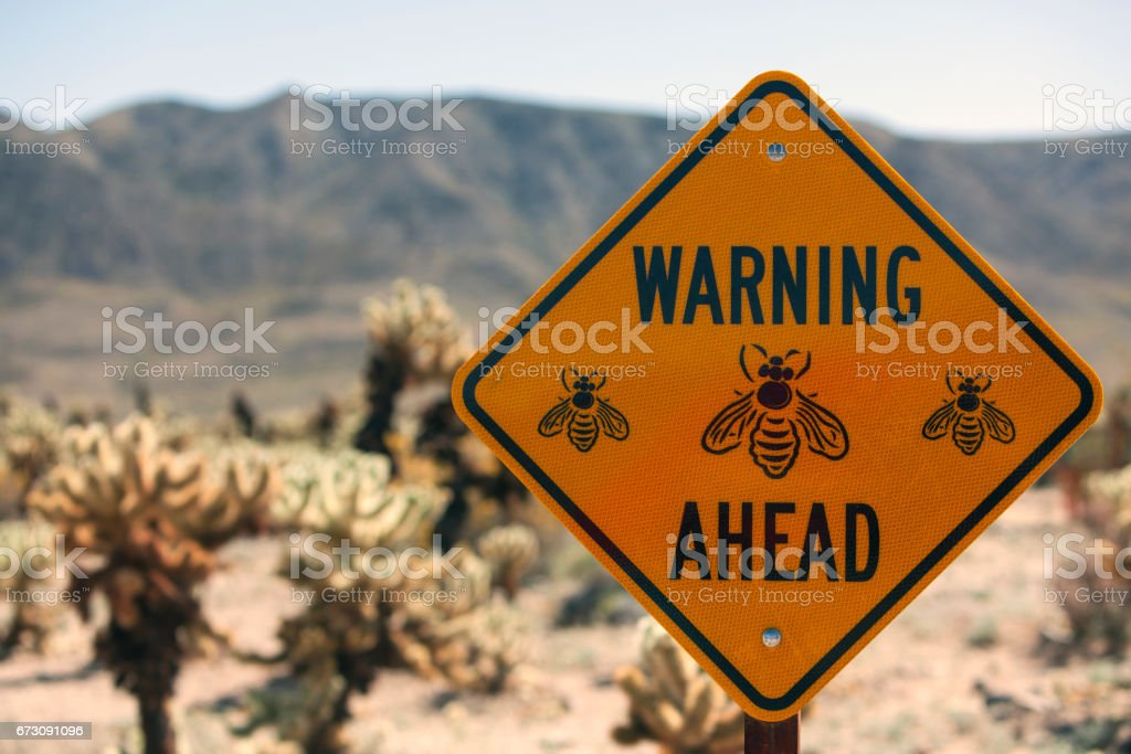 Bee Warning Sign stock photo