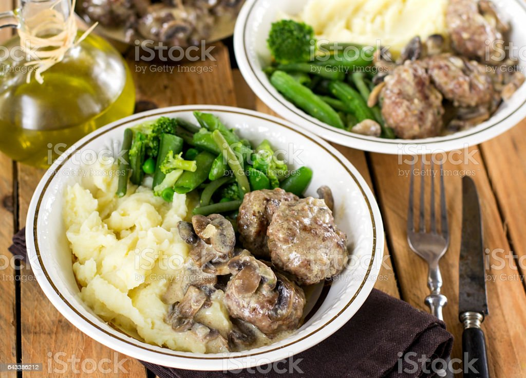 Beef and veal meatballs in creamy mushroom sauce stock photo