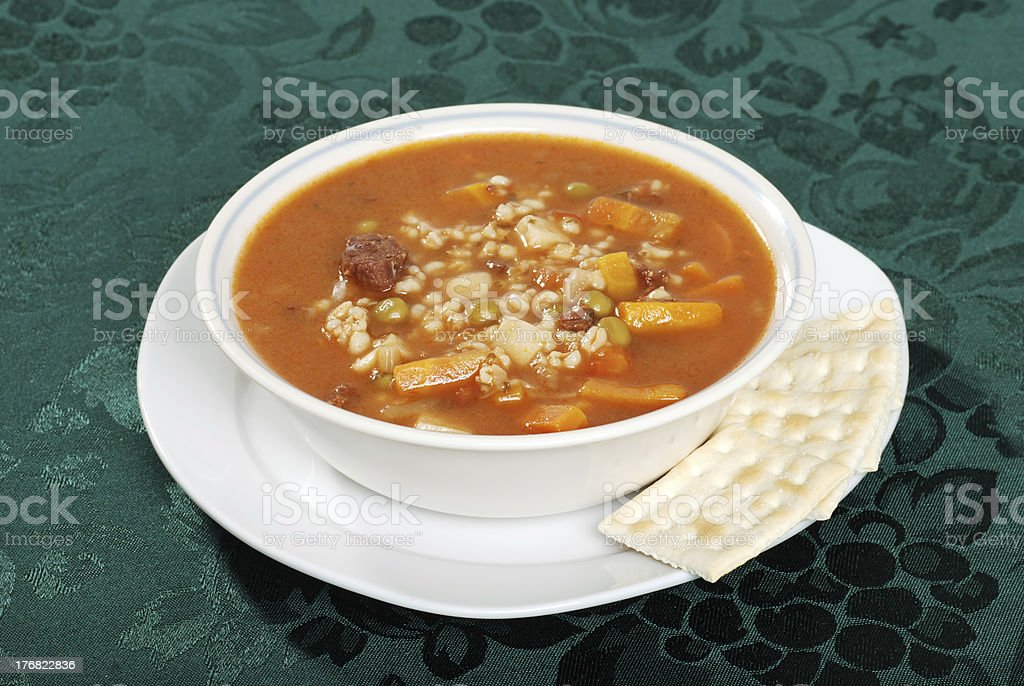 beef barley soup with crackers stock photo