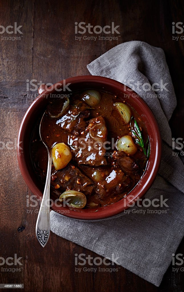 Beef braised in red wine sauce stock photo