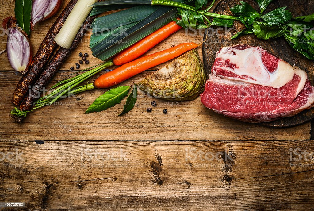 Beef brisket with vegetables ingredients for soup or broth cooking stock photo