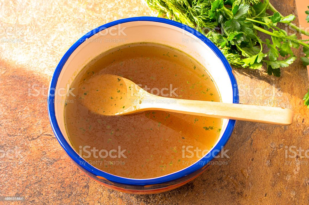 Beef broth with herbs stock photo