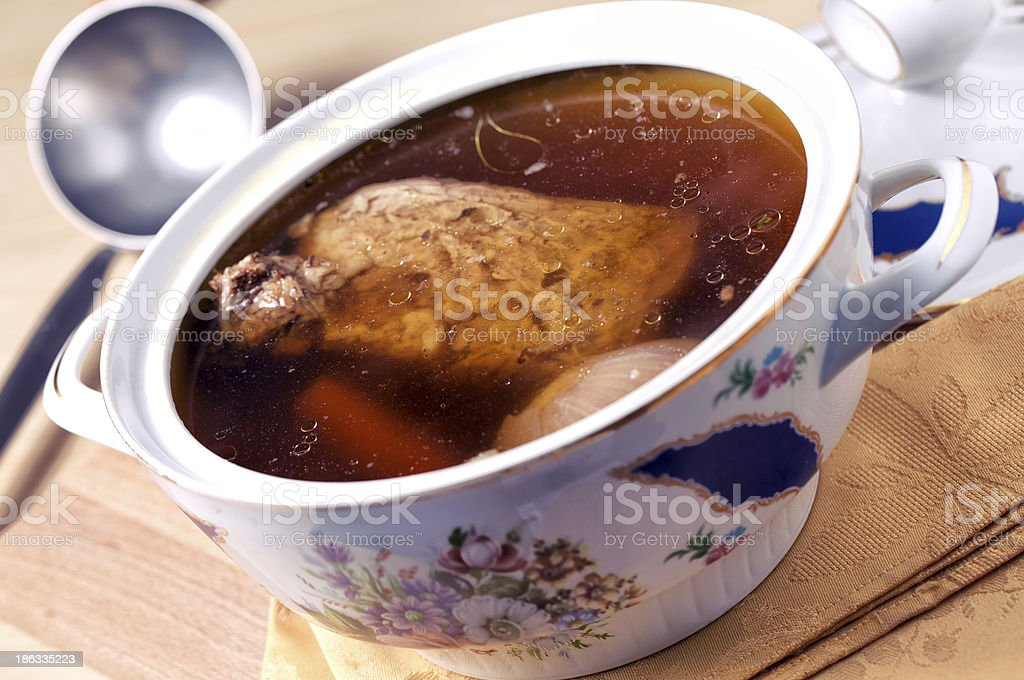 Beef broth with potatoes, carrots and onions stock photo