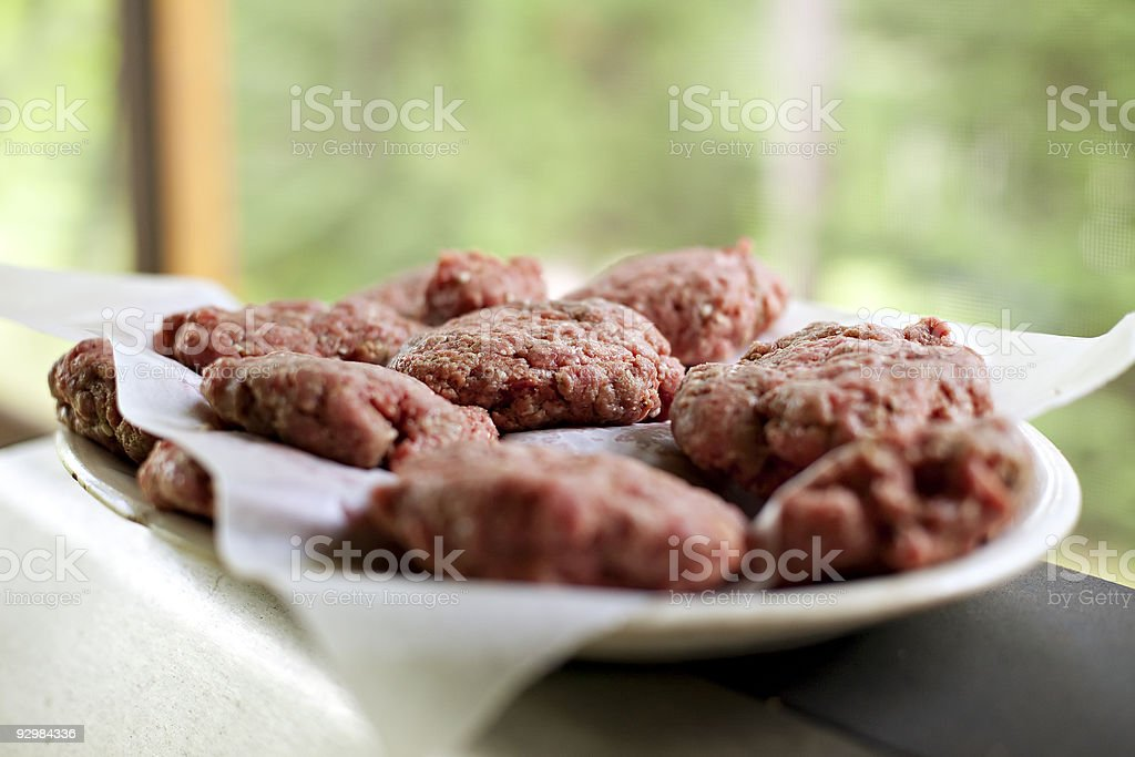 Beef burger patties ready for the grill stock photo