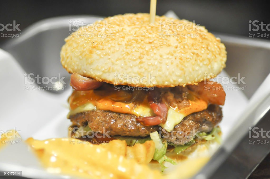 beef burger with cheese and sesame stock photo