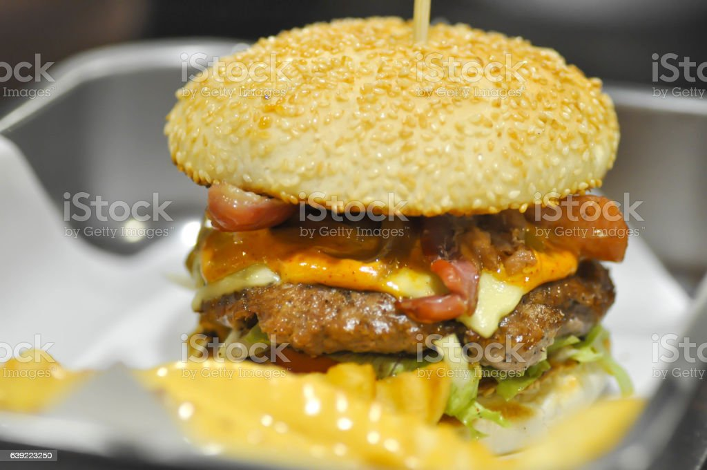 beef burger with cheese  and vegetable stock photo