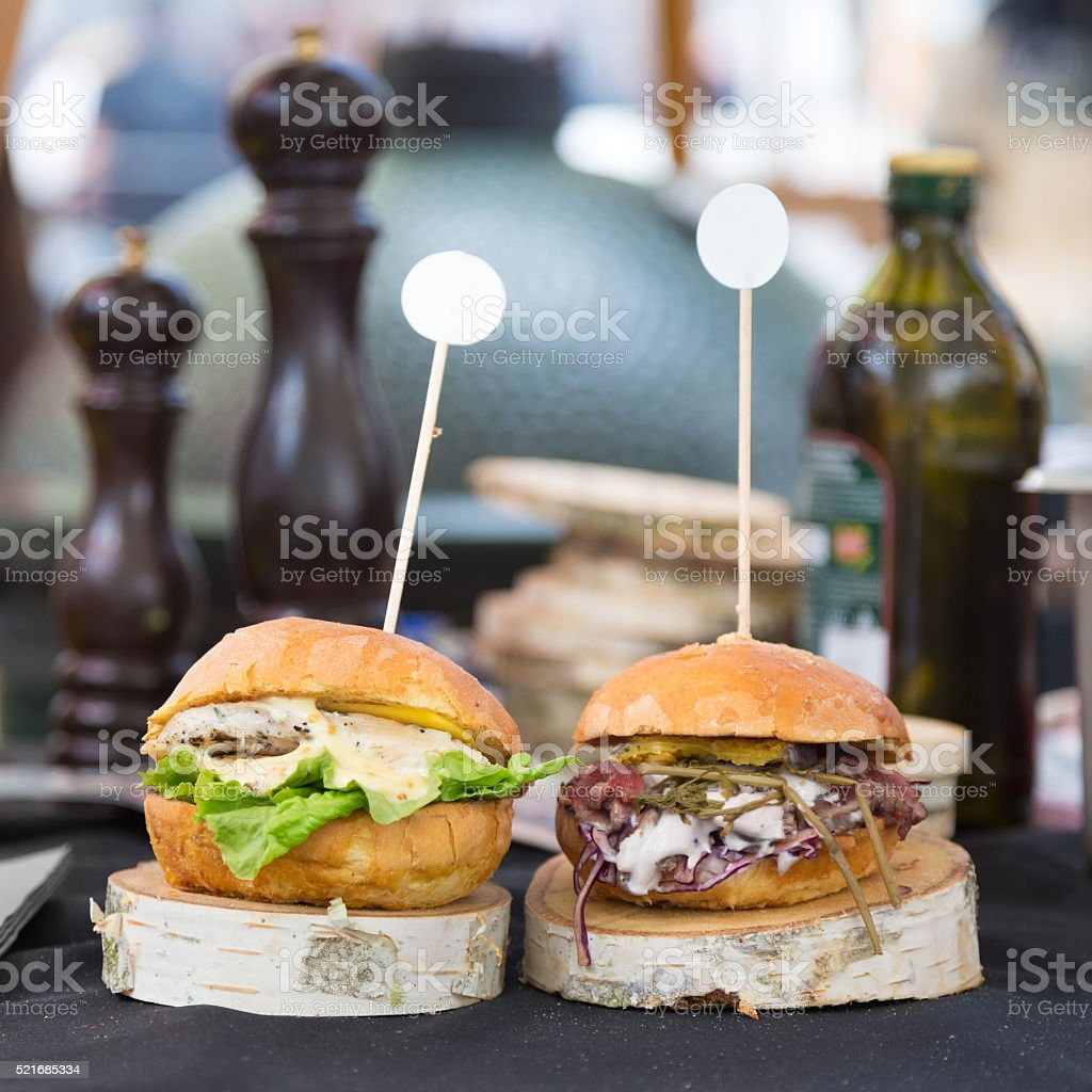 Beef burgers being served on street food stall stock photo