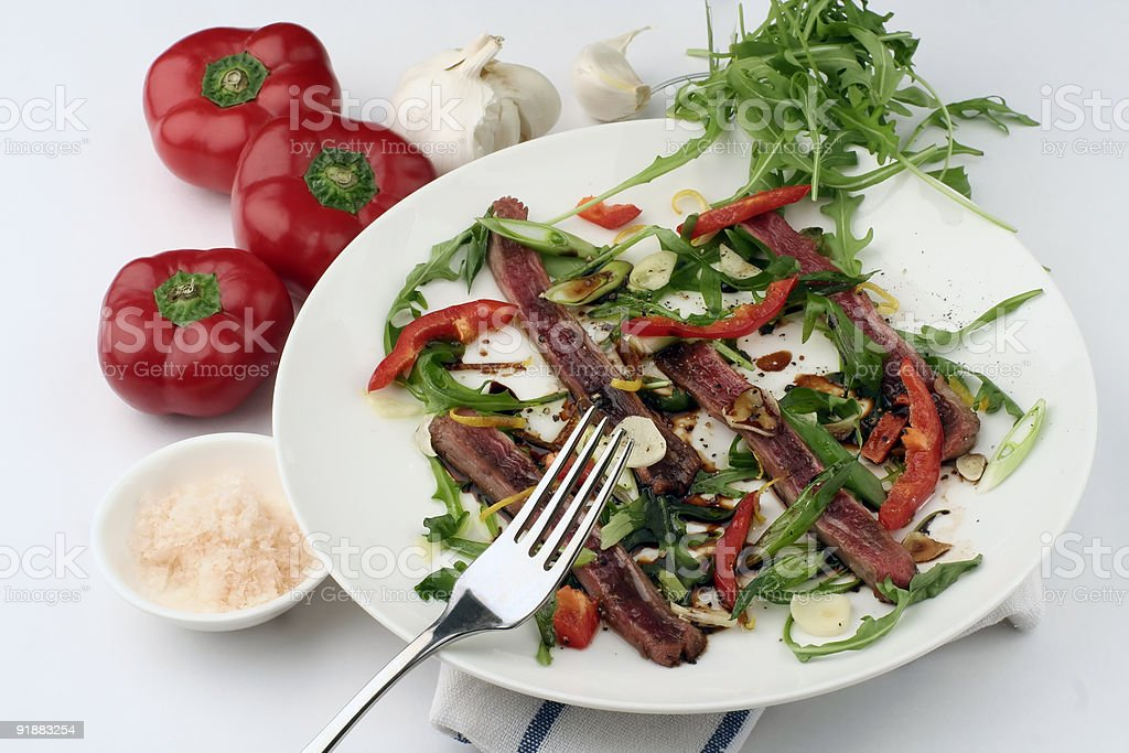 Beef Carpaccio; full sharp wide view with fork royalty-free stock photo