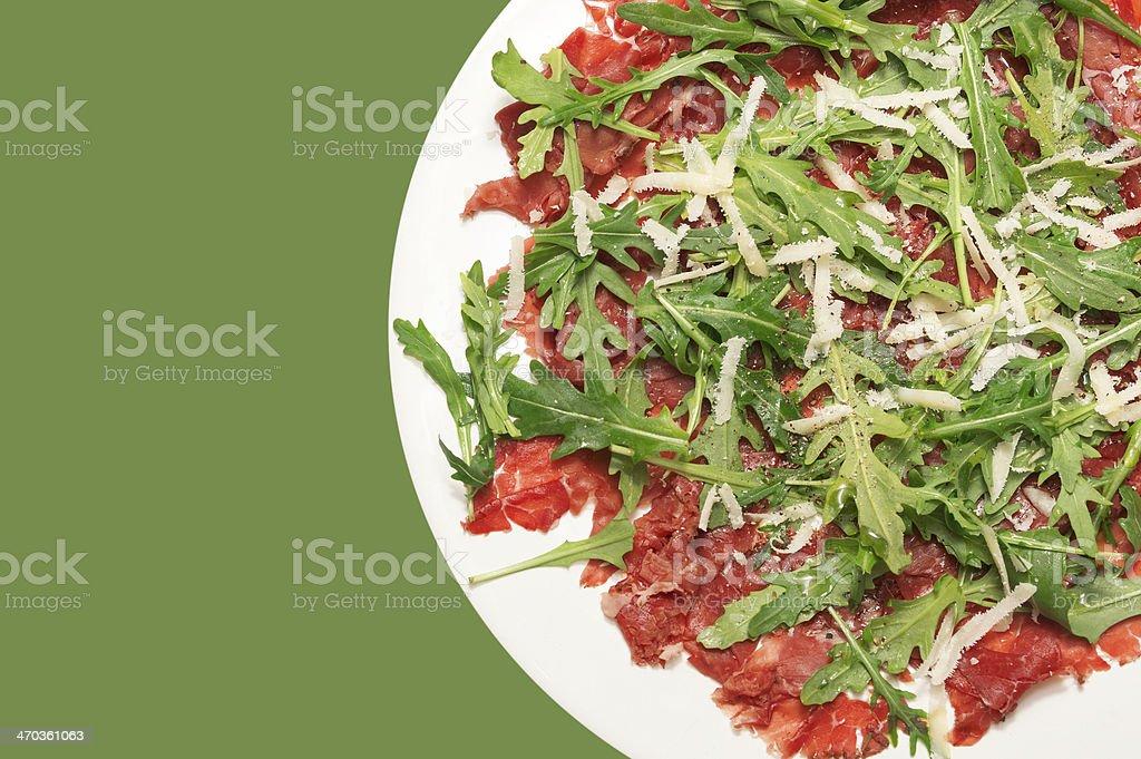 Beef carpaccio on green background stock photo