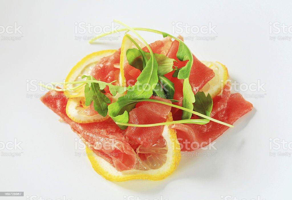 Beef Carpaccio with lemon royalty-free stock photo