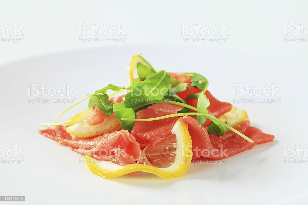 Beef Carpaccio with lemon royalty-free stock photo