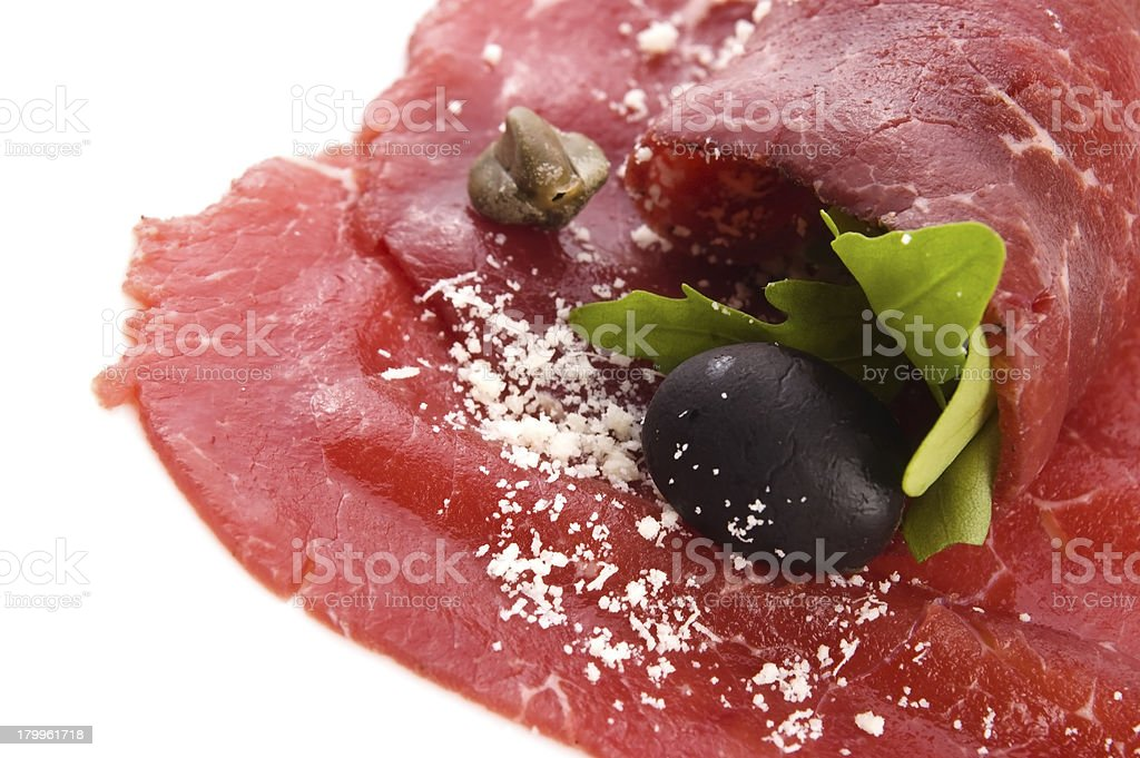 Beef carpaccio with rucola and parmesan royalty-free stock photo