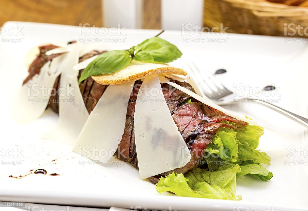 beef carpaccio with spicy cheese and arugula royalty-free stock photo