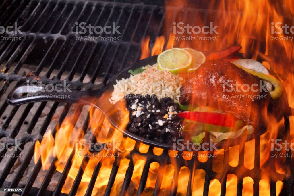 Beef, Chicken and Shrimp Fajitas Cooking on a Grill stock photo