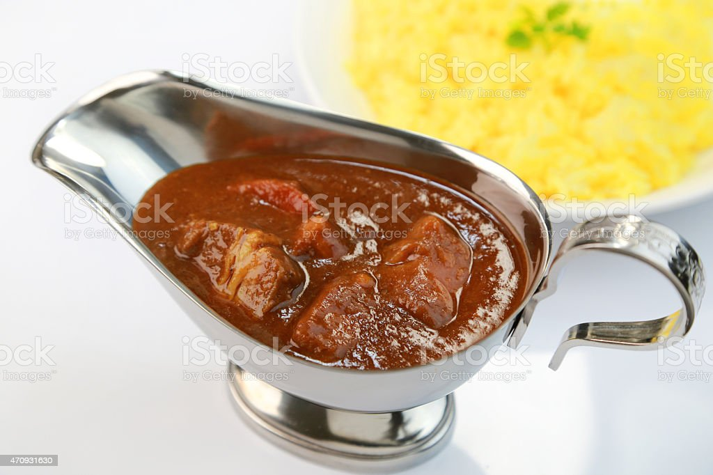 Beef curry and a bowl of pilau rice stock photo