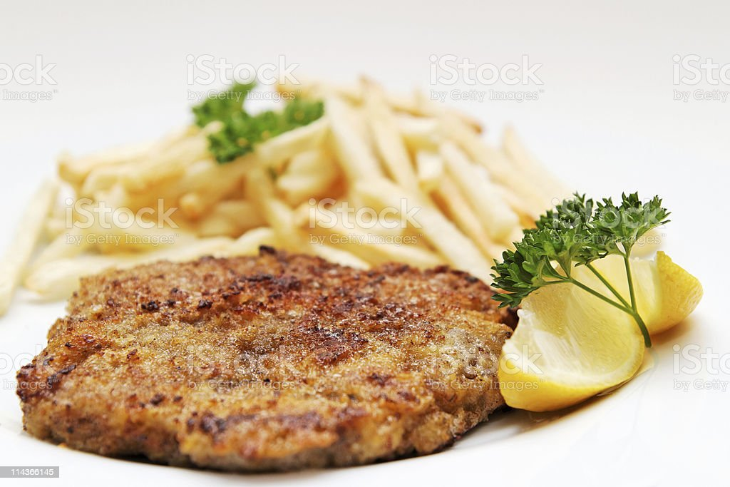 Beef cutlet with french fries royalty-free stock photo
