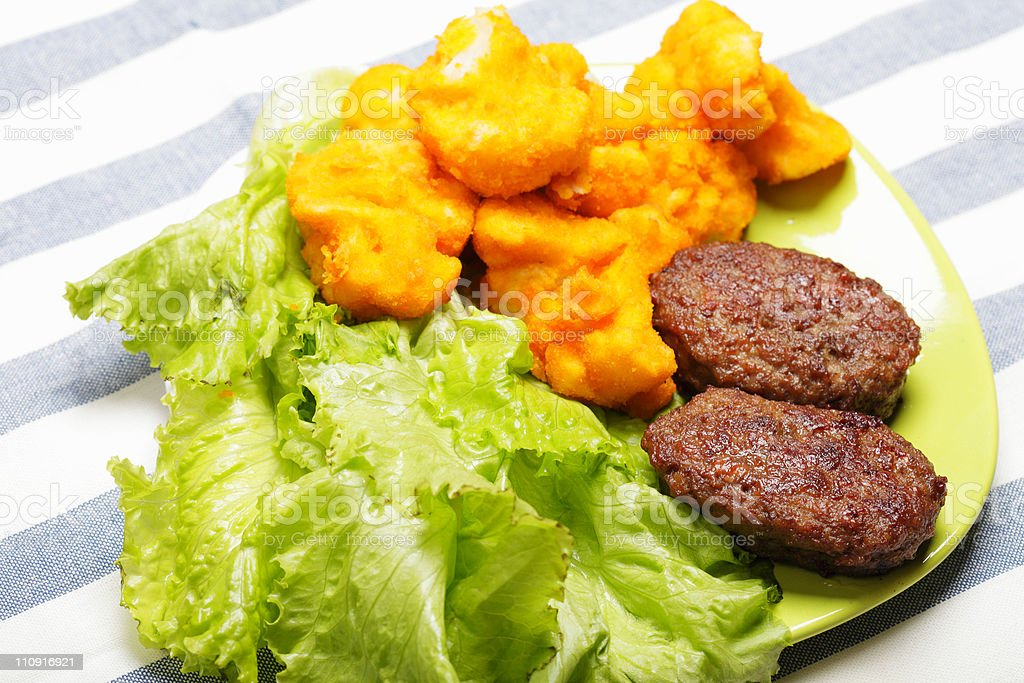 Beef cutlets and breaded cauliflower royalty-free stock photo