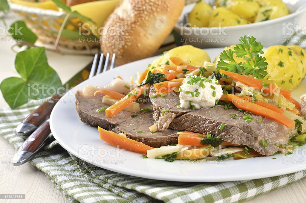 Beef dinner on plate with carrots and other vegetables stock photo