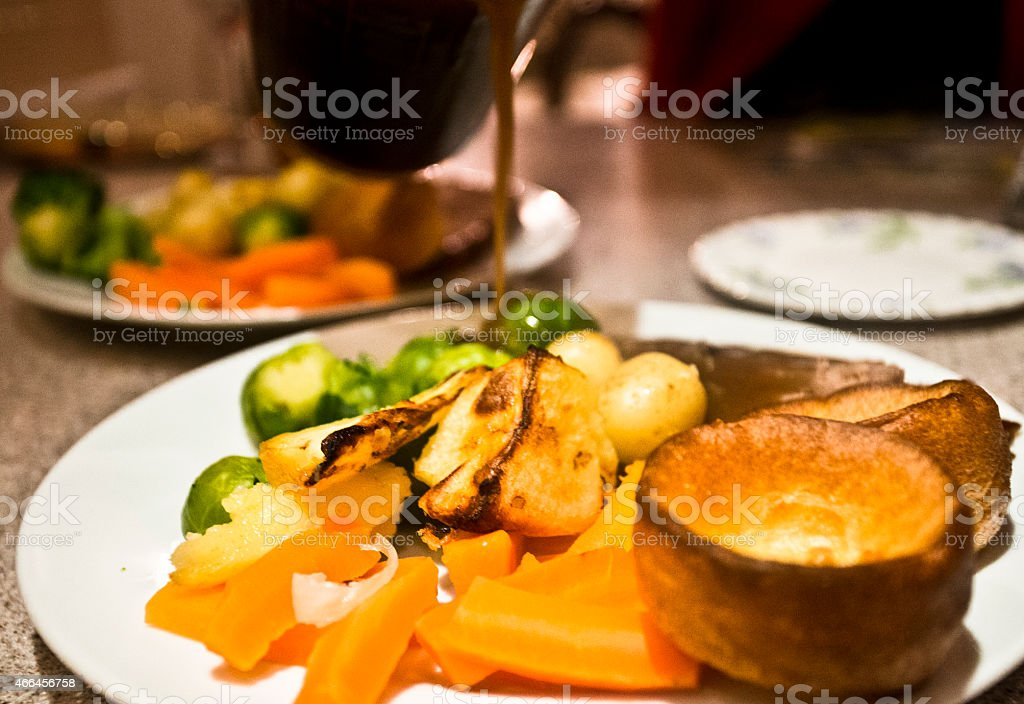 beef dinner with yorkshire pudding stock photo
