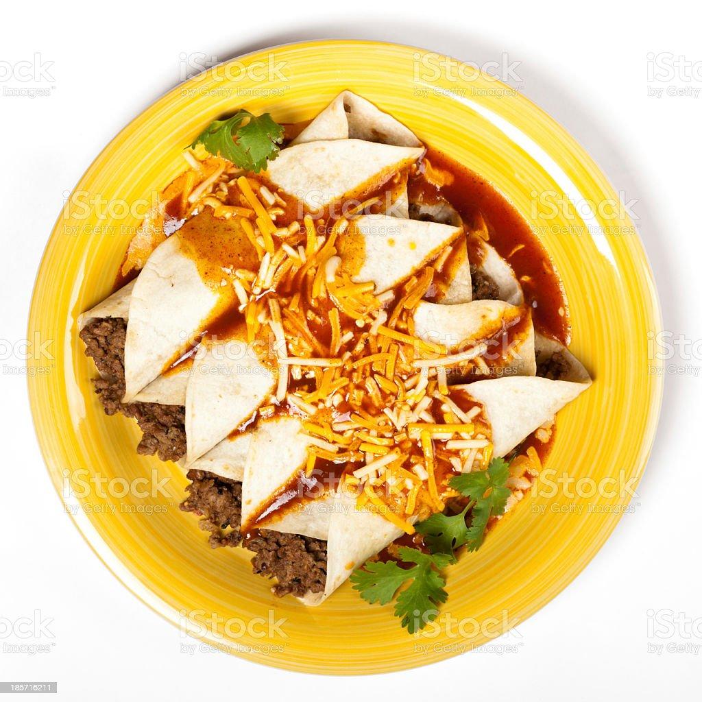 Beef enchiladas on yellow plate stock photo