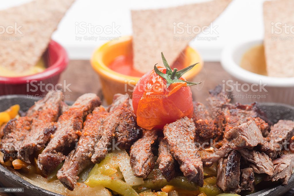 Beef Fajitas wit mexican sauce and smoke stock photo