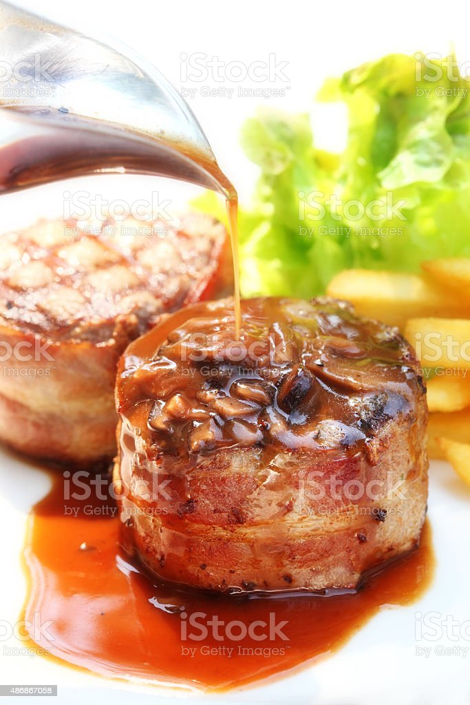 Beef Filet Mignon with suace - Tenderloin steak and bacon stock photo