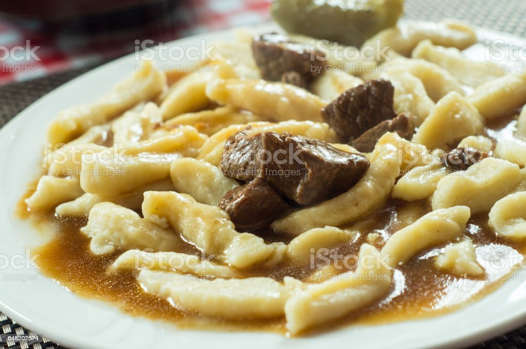 beef goulash with noodles stock photo