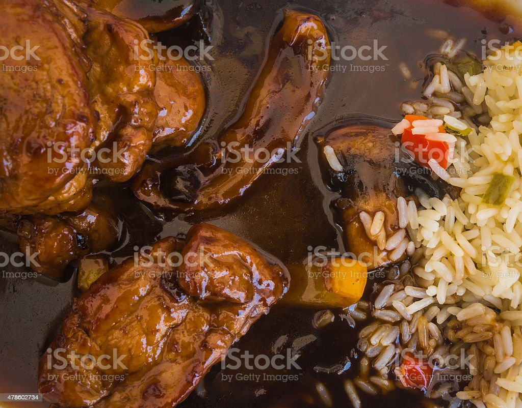 Beef in honey sauce with rice stock photo