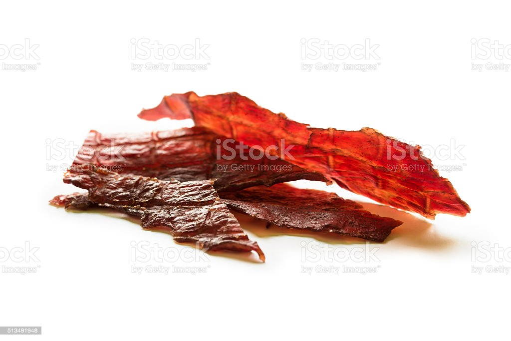 Beef jerky isolated on a white studio background stock photo