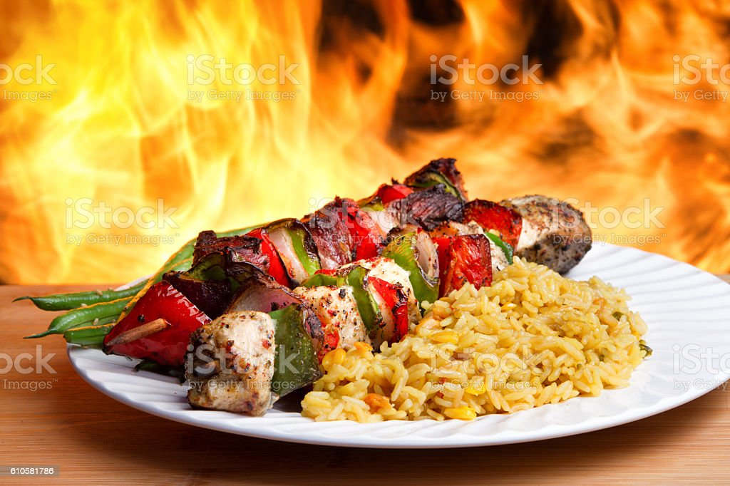 Beef Kebabs Near a Fiery Grill with Flames stock photo