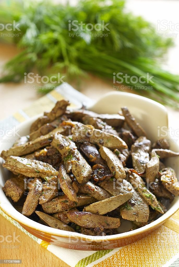 Beef liver with onions and herbs royalty-free stock photo