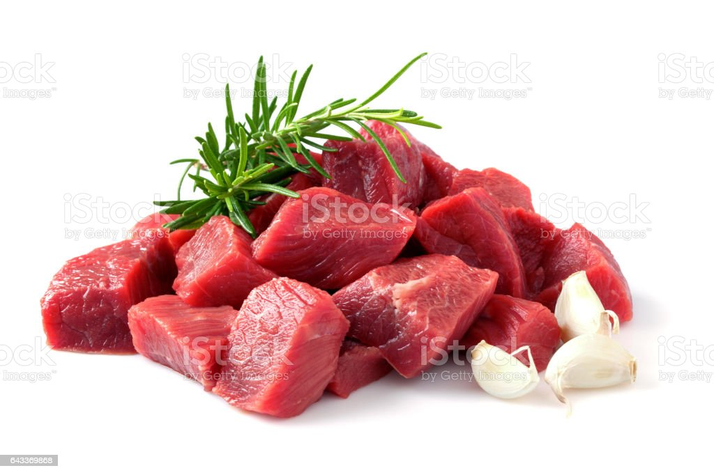 Beef meat cubes with rosemary herb and garlic stock photo