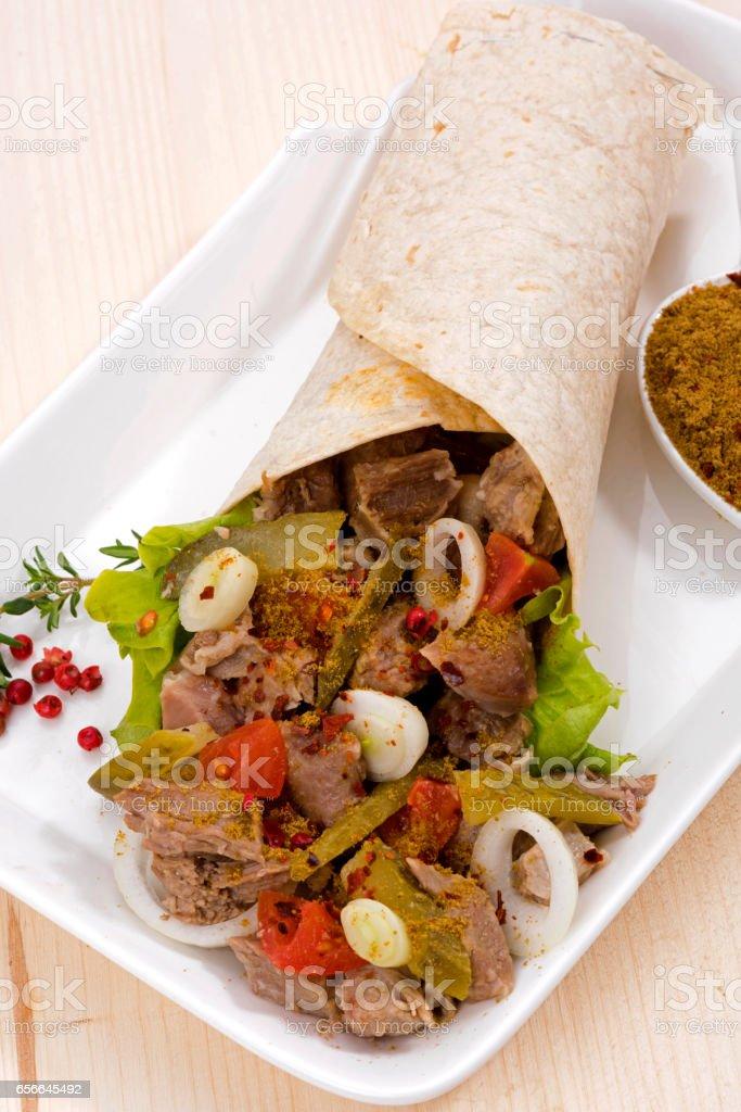 Beef meat Tantuni traditional turkish kebap durum lavash stock photo