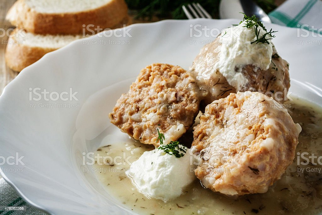 Beef meatballs in dill sauce stock photo