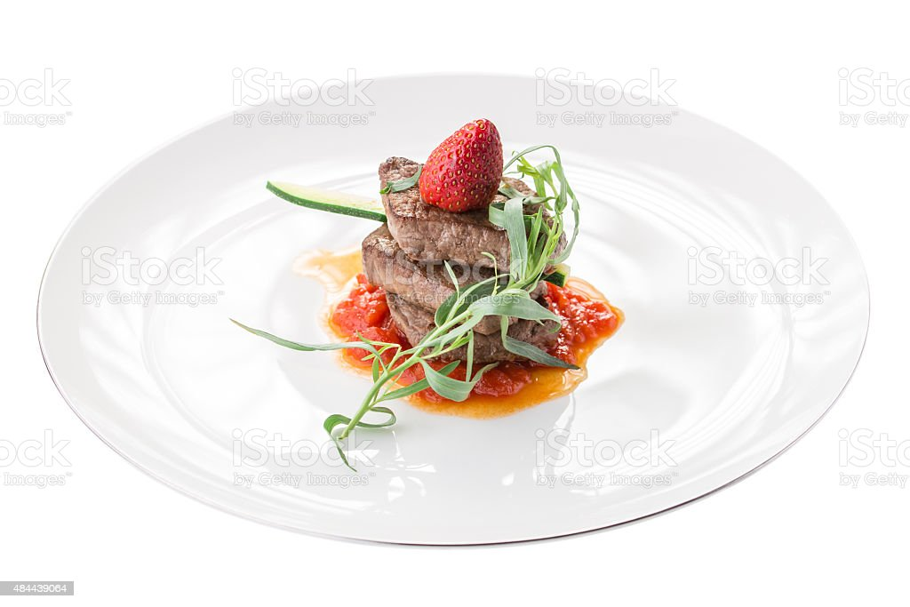 Beef medallion with strawberry stock photo